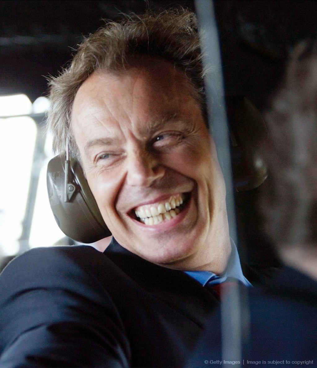 Britain's Prime Minister Tony Blair smil