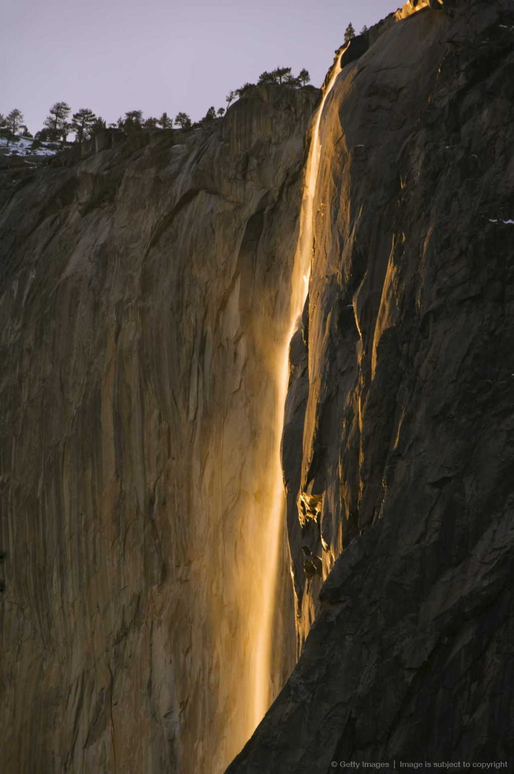 Afternoon light on Horsetail Falls, a phenomenon that occurs once or twice a year in late February due to the angle of the sun and snow melt on the cliffs,...