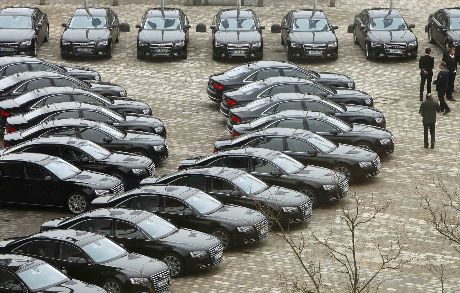 Audi A8's are parked in front of headquarter before Audi's annual news conference in Ingolstadt