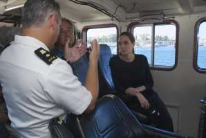 UN High Commissioner for Refugees Antonio Guterres and U.S. actress and UNHCR Special Envoy Angelina Jolie talk with an Armed Forces of Malta officer on...